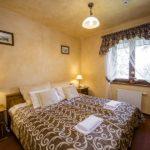 Double bed in Karolowka hotel